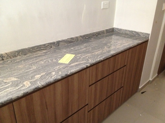 The marbly looking granite installed for our kitchen counter tops. Very shiny